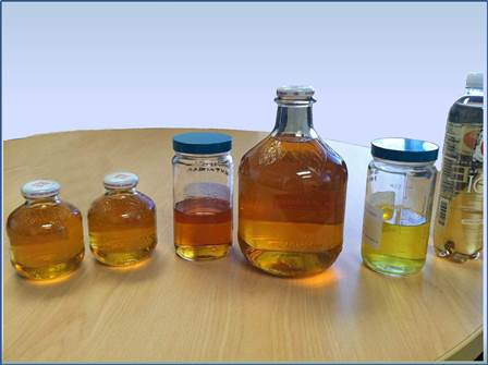 Various glass containers with liquids inside